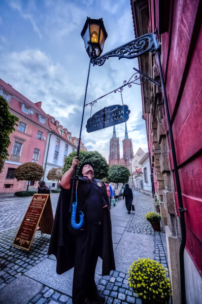 The Wroclaw's lamplighter at work