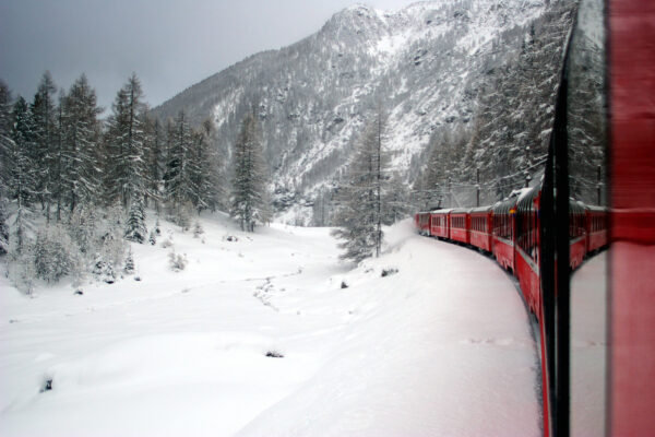 Bernina Express: riding the Alps by train - Reflection of the train under the snow
