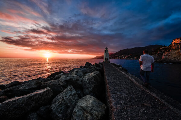 Camogli pier and lighthouse at sunset. Same POV as the image above, but different treatmemtat sunset