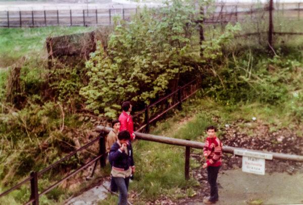 Four schoolboys facing the Iron Curtain.