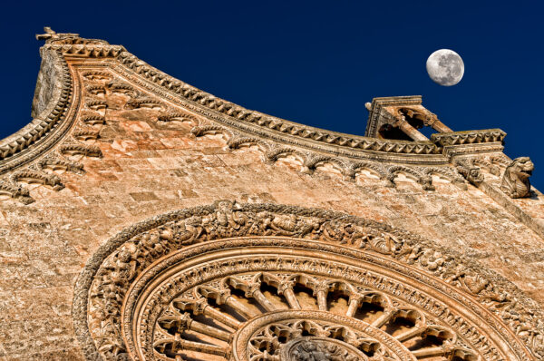 Moon and the stone Ostuni cathedral at sunset