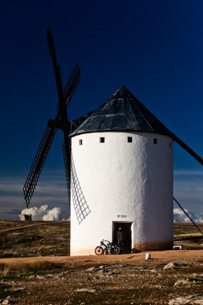 Windmills of La Mancha -Modern Sancho A windmill and a motorbiki in Campo de Criptana