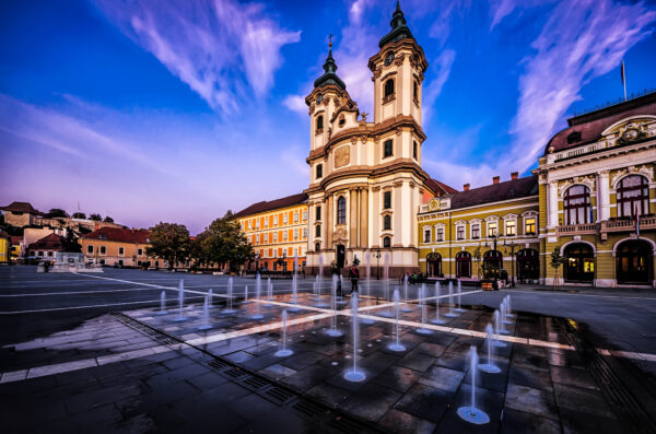 Eger beautiful town in Hungary. Dobo Square with church and fountain