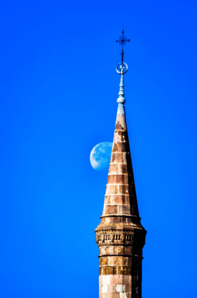 Eger minaret and rising moon