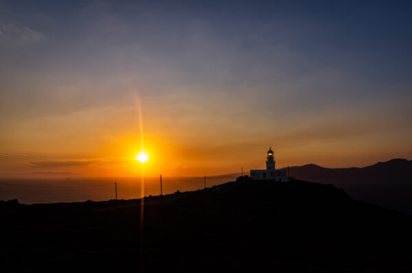 Out of the crowd in Mykonos, Armenisti lighthouse at sunset, Mykono, Cyclades, Greece