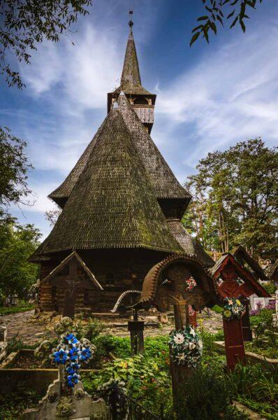 Ieud wooden church and graveyard Maramures Romania UNEWSCO