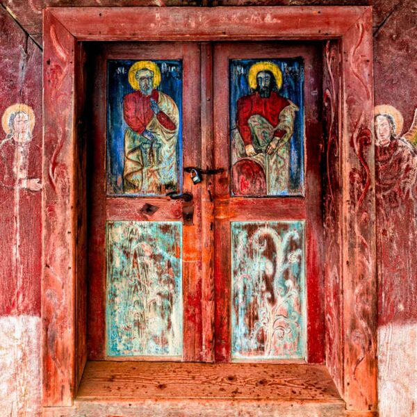 Ancient paintings on wood on the entrance door of Poienile Izei wooden church. Maramures Romania UNESCO Heritage