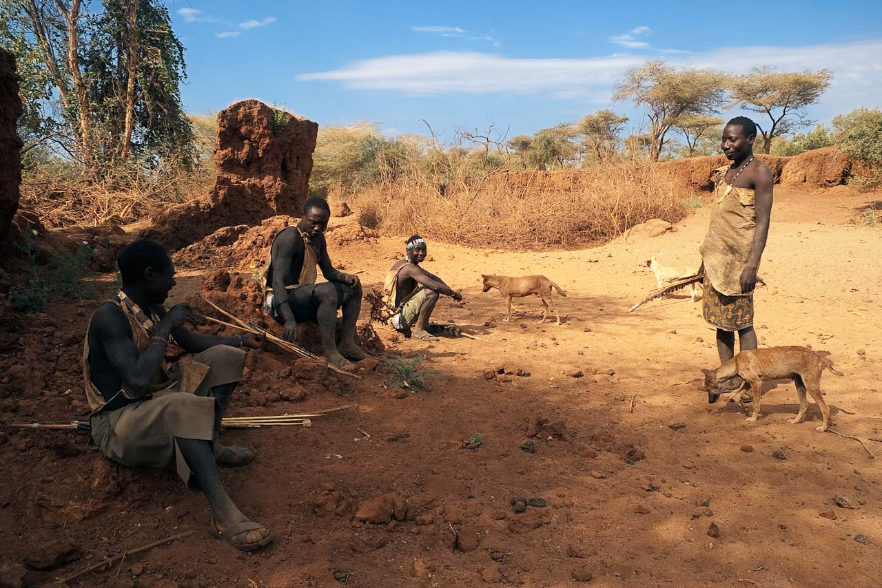 Hadzabe people relaxing during a hunting trip
